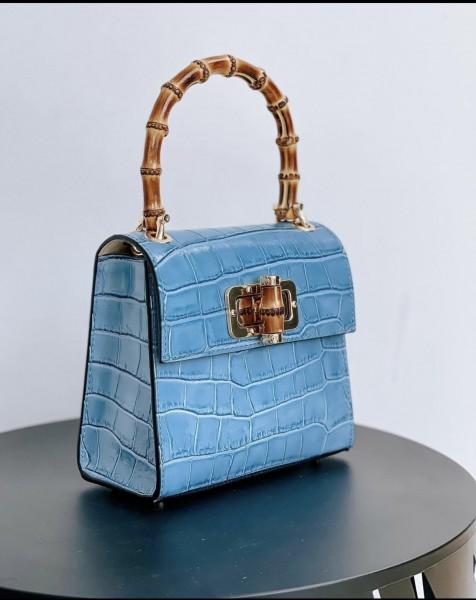 Handtasche in geprägtem Leder mit Bambusgriff von Massimilianoincas